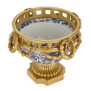 Pair of porcelain and gilt bronze pot-pourri vases, retailed by Boin-Taburet