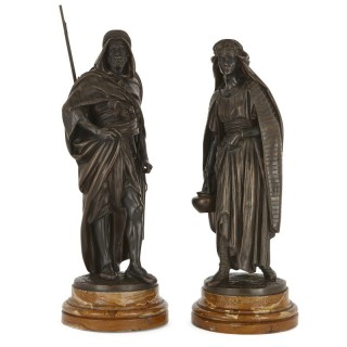 'La Porteuse' and 'Le Guerrier Arabe', two patinated bronze sculptures by Salmson