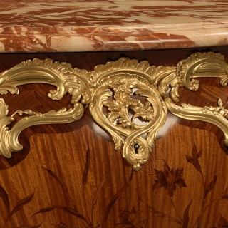 A Louis XV Style Marquetry and Gilt-Bronze Mounted Commode