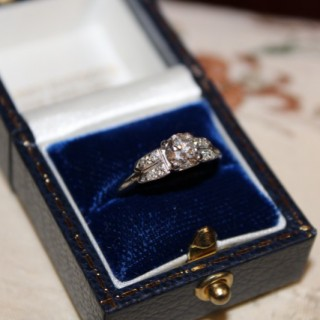 A fine Platinum Diamond Solitaire with Double Diamond Shoulders, English circa 1935