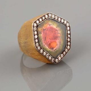 A gold, diamond and watermelon tourmaline ring.