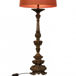 A CARVED 18TH CENTURY LAMP