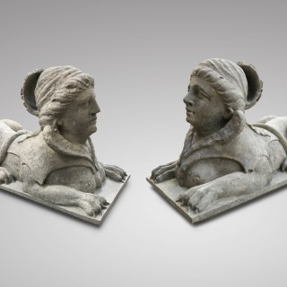 A RARE PAIR OF CARVED STONE SPHINX
