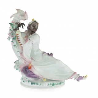 A Meissen Art Deco Figure of an Arab man with cockatoo