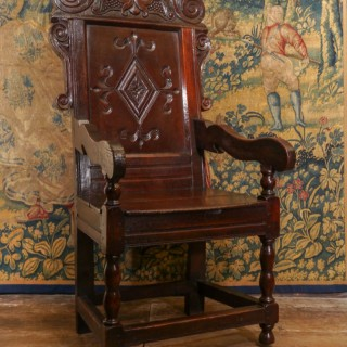 An Impressive Charles II Oak Panel Back Armchair