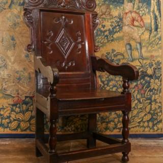 An Impressive Charles II Oak Panel Back Armchair