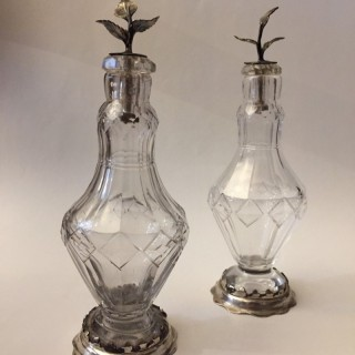 Pair of early 18th century cut glass condiment bottles.