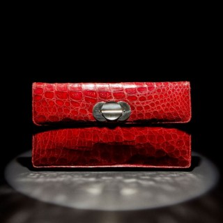 A large red crocodile clutch bag, circa 1945-50
