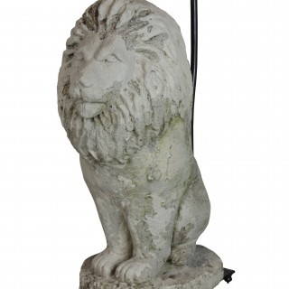 A PAIR OF STONE LION LAMPS