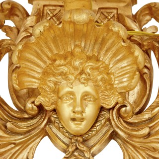Four antique gilt bronze fifteen-light wall sconces