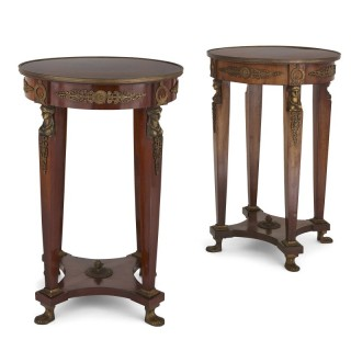 Two Neoclassical style wooden guéridons with gilt bronze mounts