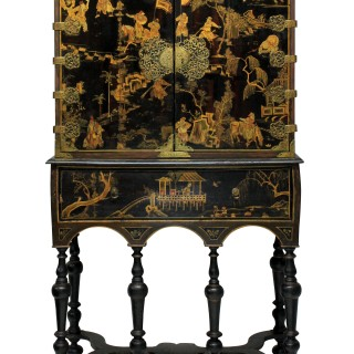 A WILLIAM & MARY BLACK & GILT JAPANNED CABINET ON STAND