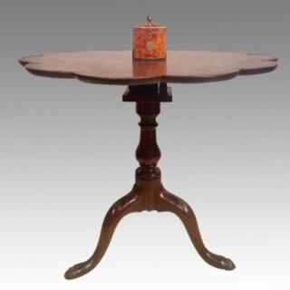Geo II carved mahogany tripod table.