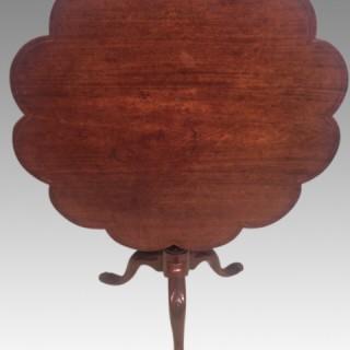 Geo II carved mahogany tripod table.