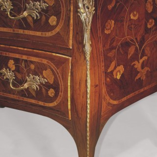 An unusual mid-18th century Portuguese serpentine, rosewood, tulipwood crossbanded, floral marquetry commode