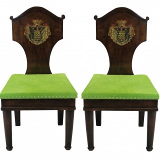 A PAIR OF ARMORIAL HALL CHAIRS IN THE MANNER OF THOMAS HOPE