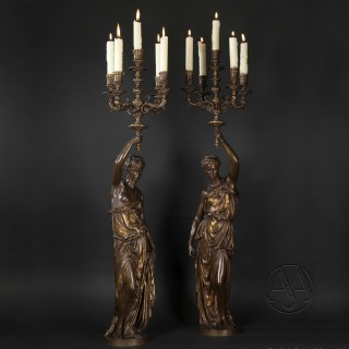 A Pair of Gilt and Patinated Bronze Figural Five-Light Candelabra