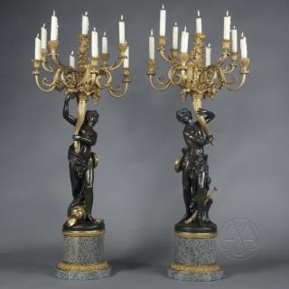 'Les Grands Faunes', A Large Pair of Bronze Figural Candelabra