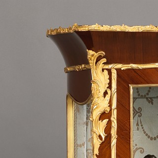 A Louis XV Style Gilt-Bronze Mounted Serpentine Vitrine
