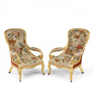 A pair of Victorian gilt wood and needlework arm chairs by Gillows 1850