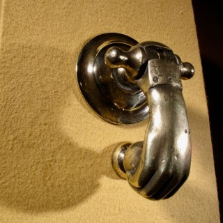 An Interesting Bronze Door Knocker In The Shape Of A Hand.