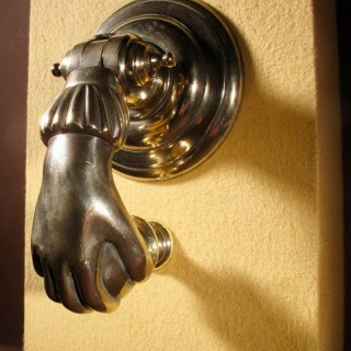 An Interesting Bronze Door Knocker In The Shape Of A Hand