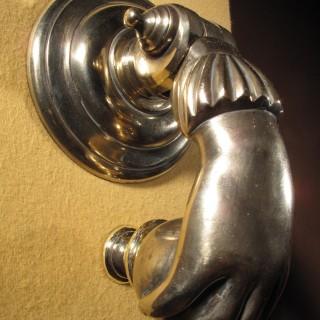 An Interesting Bronze Door Knocker In The Shape Of A Hand