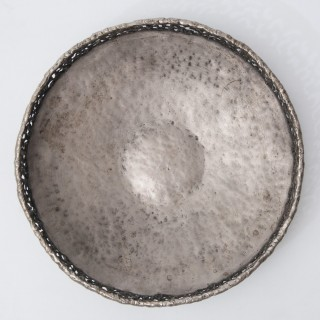 Torch cut and hammered metal bowl by Marcello Fantoni