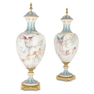 Two large gilt bronze mounted Rococo style white porcelain vases