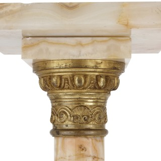 Two French white onyx and gilt bronze column pedestals