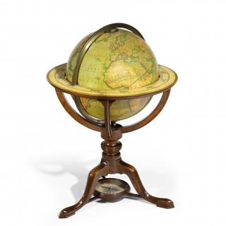A pair of Carys 12 inch library table globes in mahogany stands