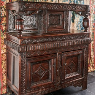 Charles I oak canted press cupboard
