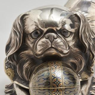 A silver Okimono of a Japanese Chin dog
