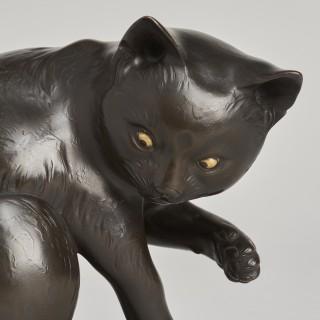 A Japanese Maruki bronze Okimono of a playful cat