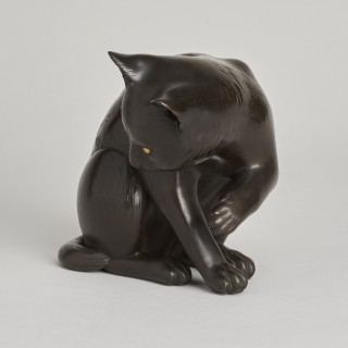 A Japanese Maruki bronze Okimono of a playful cat