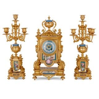 Sèvres style porcelain and gilt bronze three-piece clock set