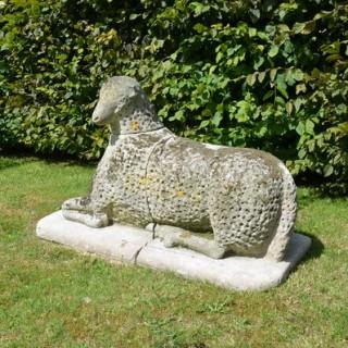 A large carved natural Bath stone Folk Art sheep