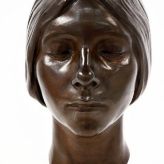 A bronze portrait bust of a young women by Herbert Palliser 1883-1963