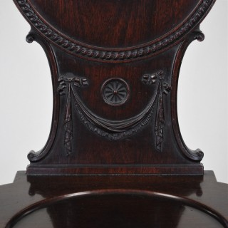 Pair of mahogany Hall Chairs with painted armorials