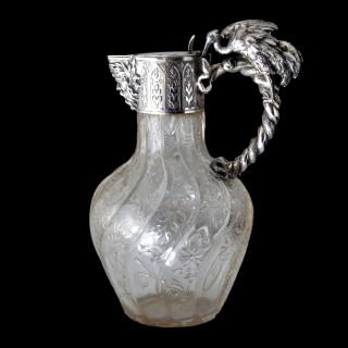 An extraordinary pair of Austro-Hungarian silver snake handled claret jugs