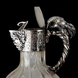 An extraordinary pair of Austro-Hungarian silver snake handled claret jugs