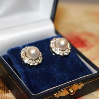A fine pair of 18ct White Gold (marked), Cultured Pearl and  Diamond Cluster Earrings, Circa 1950-1960
