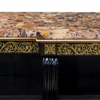 A Regency brass-inlaid ebonized breakfront bookcase