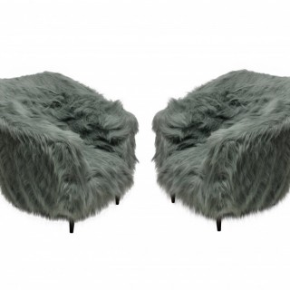 A PAIR OF MID-CENTURY ARMCHAIRS IN FUR