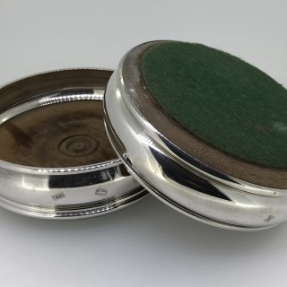 Pair of Silver Bottle Coasters