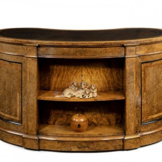 Victorian kidney-shaped desk in richly figured burr walnut by Gillows