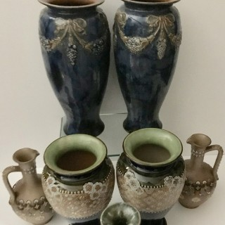 Seven Lambeth Doulton vases sold as a collection.