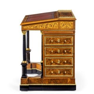 An outstanding high Victorian freestanding burr-walnut Davenport desk