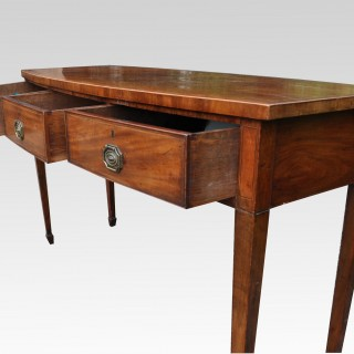 A George III mahogany bow fronted three drawer side/serving table/sideboard