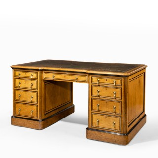 A small Victorian oak and ebony partner's desk, attributed to Holland and Son (England, 1880)